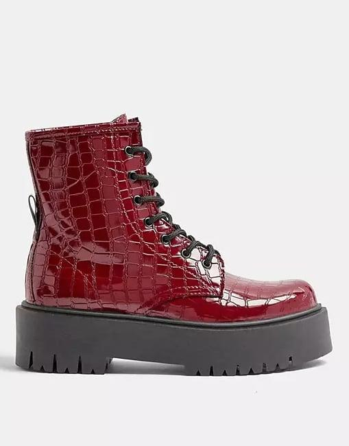 <p><span>Topshop Chunky Croc Patent Boots in Burgundy</span> ($80)</p>