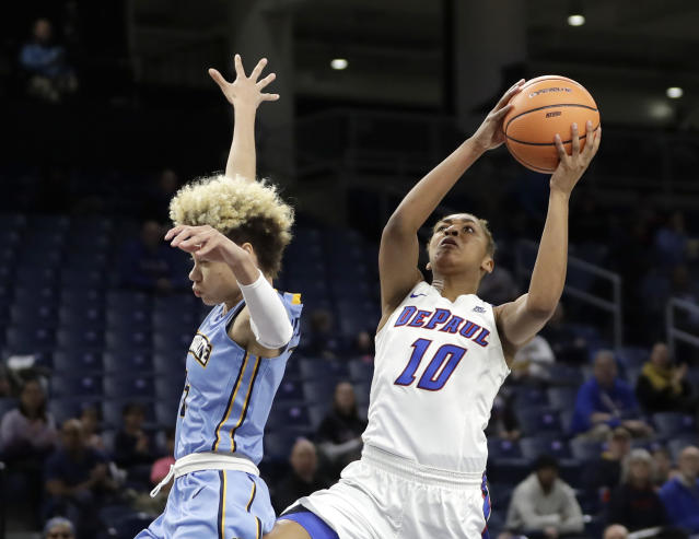 DePaul's Amarah Coleman (10) drives past Marquette's Natisha Hiedeman during the first half of an NCAA college basketball game in the championship of the Big East conference tournament, Tuesday, March 6, 2018, in Chicago. (AP Photo/Charles Rex Arbogast)
