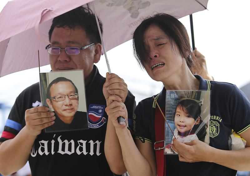 Relatives of passengers onboard the TransAsia Airways plane that crashed cry at a funeral parlor on Penghu