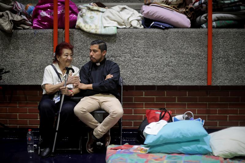Awoman talks with a priest two days after theearthquake in Mexico City, Mexico. The earthquake comes 32 years after a magnitude-8.0 earthquake hit on September 19, 1985.