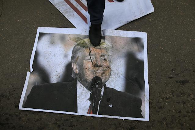 <p>A Palestinian protestor steps on a poster of President Donald Trump following his decision to recognise Jerusalem as the capital of Israel, in Gaza City, on Dec. 7, 2017. (Photo: Mohammed Abed/AFP/Getty Images) </p>