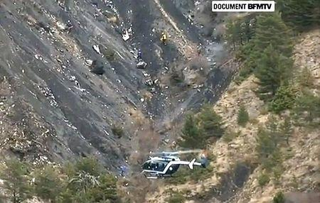 A rescue helicopter from the French Gendarmerie hovers in front of the crash site of an Airbus A320, near Seyne-les-Alpes, March 24, 2015 in this still image taken from TV.   REUTERS/BFM via Reuters TV