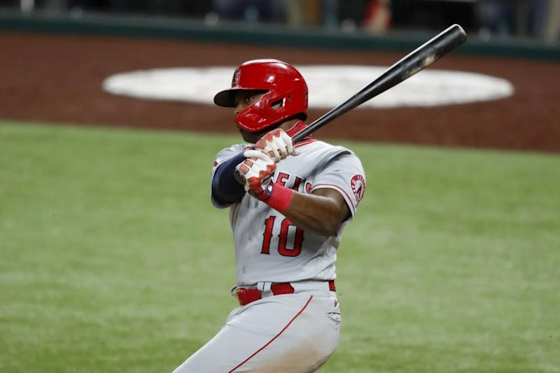 Los Angeles Angels' Justin Upton (10) follows through on a swing in a baseball game against the Texas Rangers in Arlington, Texas, Friday, Aug. 7, 2020. (AP Photo/Tony Gutierrez)