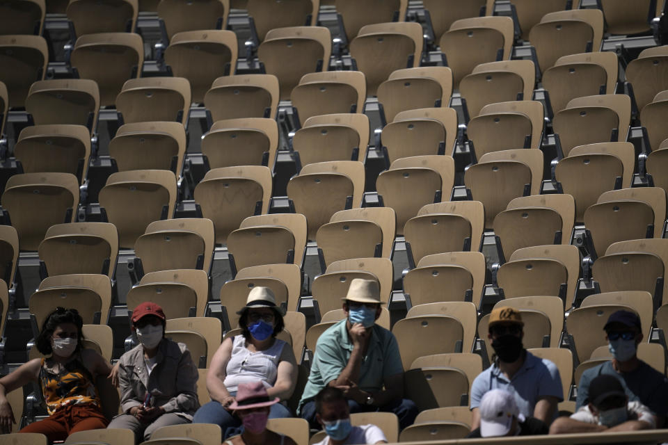 Spectators watch Japan's Naomi Osaka playing Romania's Patricia Maria Tig during their first round match of the French open tennis tournament at the Roland Garros stadium Sunday, May 30, 2021 in Paris. (AP Photo/Christophe Ena)