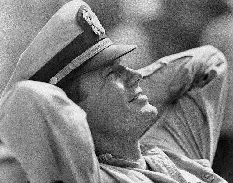 """FILE - In this Feb. 25, 1963 file photo, actor Cliff Robertson takes a break as the skipper of the PT 109, Lt. John F. Kennedy in the movie """"PT 109."""" Robertson died Saturday, Sept. 10, 2011. He was 88. (AP Photo)"""