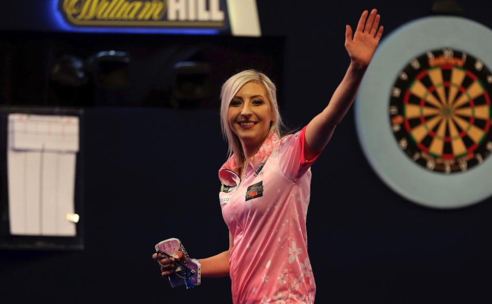 Fallon Sherrock celebrating after becoming the first women to win a game in the PDC William Hill World Championship during day five of the William Hill World Championships at Alexandra Palace, London. PA Photo. Picture date: Tuesday December 17, 2019. See PA story DARTS World. Photo credit should read: Steven Paston/PA Wire.