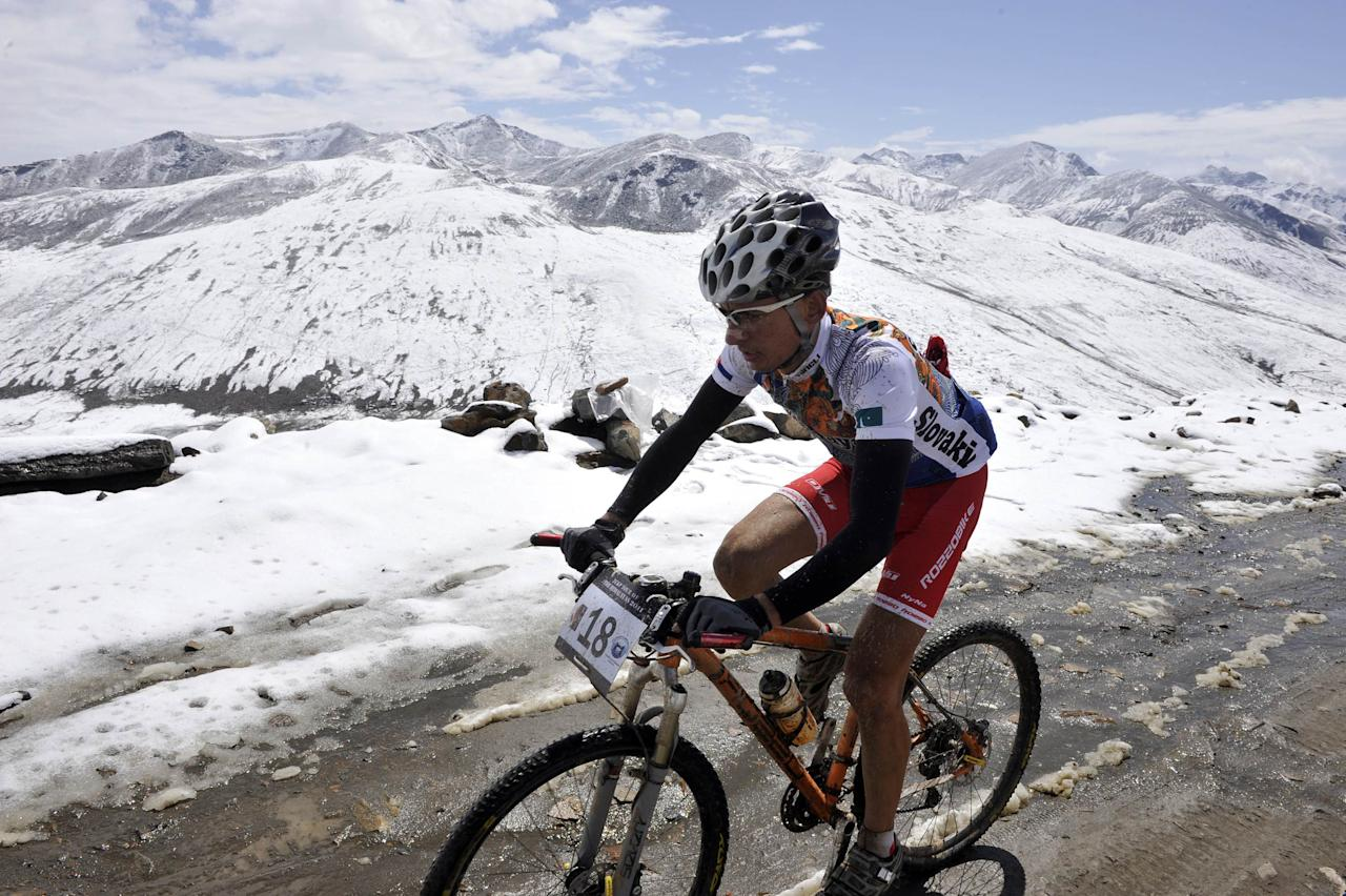 Slovakia's Martin Haring rides during the first stage of the Himalayas 2011 International Mountainbike Race in the mountainous area of Babusar in Pakistan's tourist region of Naran in Khyber Pakhtunkhwa province on September 16, 2011. The cycling event, organised by the Kaghan Memorial Trust to raise funds for its charity school set up in the Kaghan valley for children affected in the October 2005 earthquake, attracted some 30 International and 11 Pakistani cyclists. AFP PHOTO / AAMIR QURESHI (Photo credit should read AAMIR QURESHI/AFP/Getty Images)