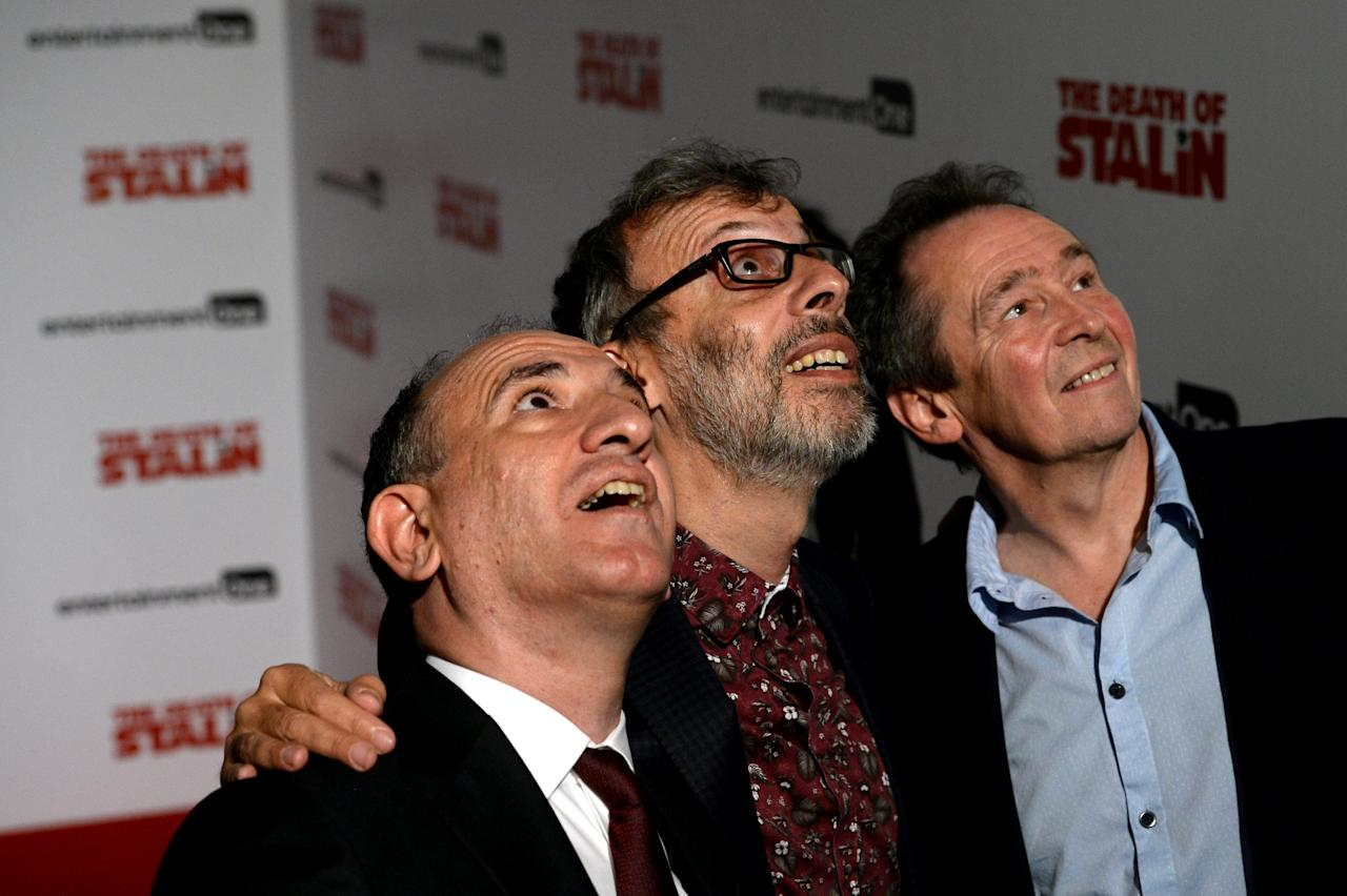 Writer and director Armando Iannucci (L) poses for photographers with actors David Schneider and Paul Whitehouse (R) at the UK premiere screening of 'The Death of Stalin', at the Curzon, Chelsea in London, Britain, October 17, 2107. REUTERS/Mary Turner