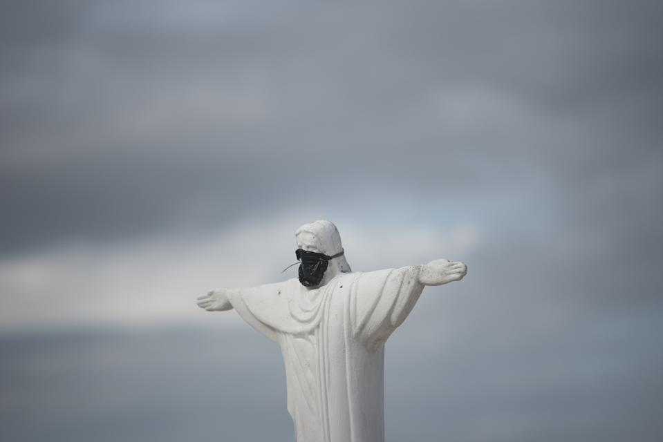 RIO DE JANEIRO, BRAZIL â April 01: Replica of Christ the Redeemer with surgical mask on Copacabana beach, to remind people about the danger of the coronavirus (COVID-19) in Rio De Janeiro, Brazil on April 01, 2020. (Photo by Fabio Teixeira/Anadolu Agency via Getty Images)