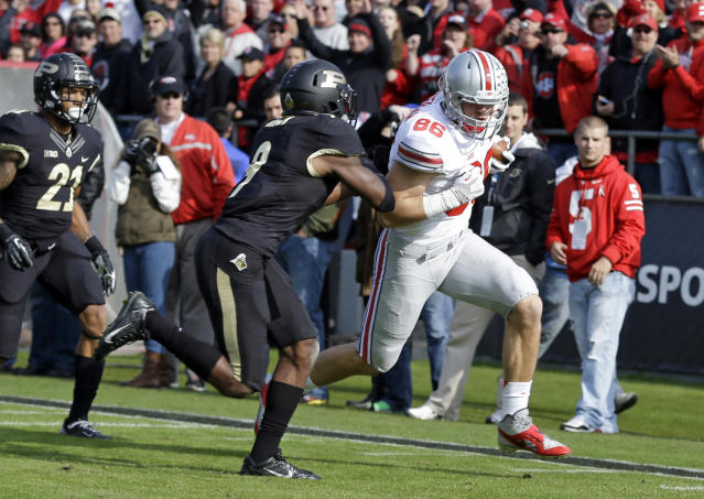Ohio State tight end Jeff Heuerman, runs past Purdue defensive back Anthony Brown for a touchdown during the first half of an NCAA college football game in West Lafayette, Ind., Saturday, Nov. 2, 2013. (AP Photo/Michael Conroy)