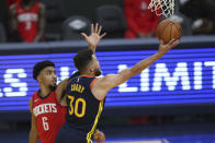 Golden State Warriors guard Stephen Curry shoots next to Houston Rockets guard KJ Martin during the second half of an NBA basketball game in San Francisco, Saturday, April 10, 2021. (AP Photo/Jed Jacobsohn)
