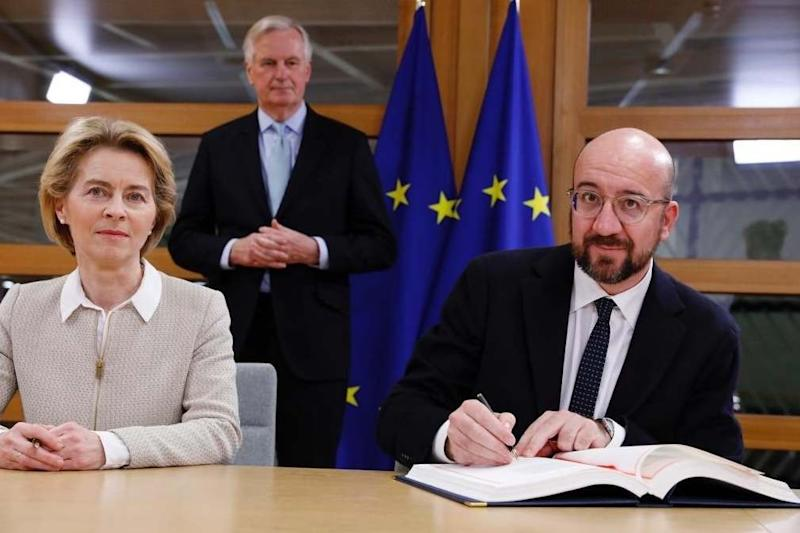 President of the European Council, Charles Michel (right) and European Commission President Ursula von der Leyen signing the Agreement on the Withdrawal of the UK from the EU, watched by EU Chief Brexit Negotiator Michel Barnier, in Brussels, Belgium (PA)