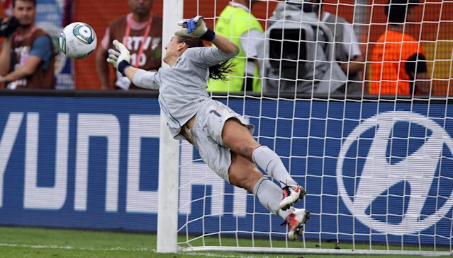 DRESDEN, GERMANY - JULY 10: Hope Solo, goalkeeper of USA saves a penalty during penalty shoot out during the FIFA Women's World Cup 2011 Quarter Final match between Brazil and USA at Rudolf-Harbig-Stadion on July 10, 2011 in Dresden, Germany. (Photo by Martin Rose/Getty Images)