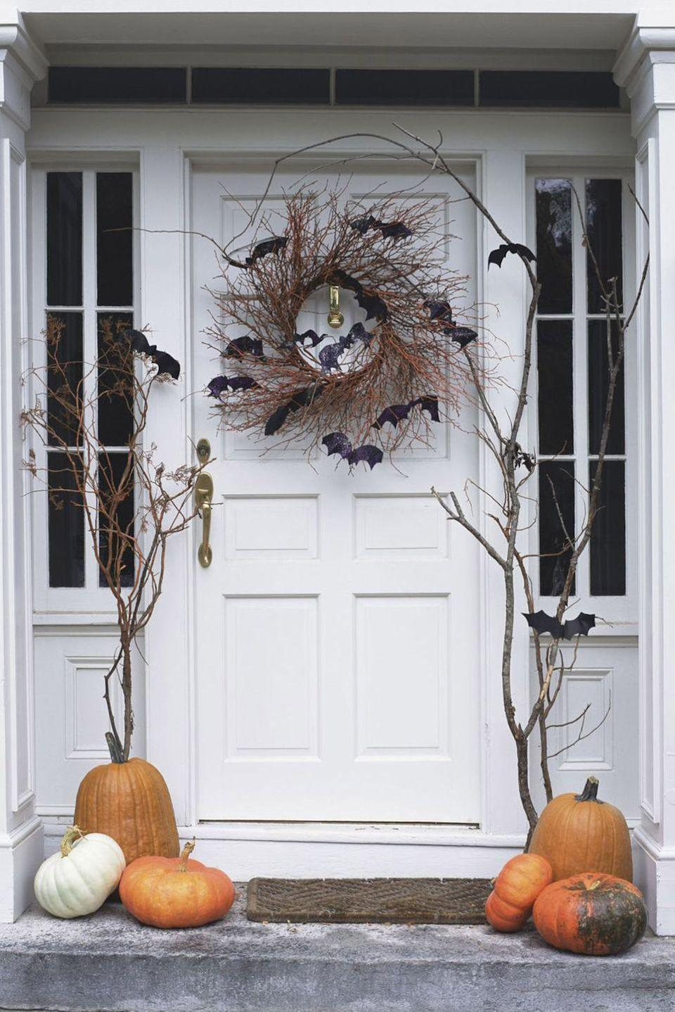"<p>Turn <a href=""https://www.countryliving.com/diy-crafts/g1370/outdoor-halloween-decorations/"" rel=""nofollow noopener"" target=""_blank"" data-ylk=""slk:outdoor Halloween decorating"" class=""link rapid-noclick-resp"">outdoor Halloween decorating</a> into a family affair! Hang a wreath, string up lights, and assemble a display of pumpkins for an arresting, haunted entrance.<br></p><p><a class=""link rapid-noclick-resp"" href=""https://www.amazon.com/s/ref=nb_sb_noss_2?url=search-alias%3Daps&field-keywords=Halloween+wreath&rh=i%3Aaps%2Ck%3AHalloween+wreath&tag=syn-yahoo-20&ascsubtag=%5Bartid%7C2139.g.34440360%5Bsrc%7Cyahoo-us"" rel=""nofollow noopener"" target=""_blank"" data-ylk=""slk:SHOP WREATHS"">SHOP WREATHS</a><br></p>"