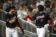 Washington Nationals' Anthony Rendon, right, high-fives teammate Trea Turner after batting him in on a three-run home run in the fifth inning of an interleague baseball game against the Chicago White Sox, Tuesday, June 4, 2019, in Washington. (AP Photo/Patrick Semansky)