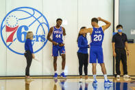 Philadelphia 76ers forward Paul Reed, (44) and Georges Niang, right, talk things over as they move from section to section during the NBA basketball team's Media Day in in Camden, N.J., Monday, Sept. 27, 2021. (AP Photo/Chris Szagola)