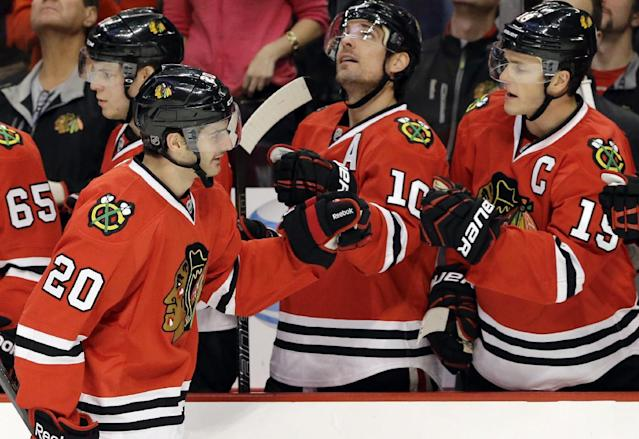 Chicago Blackhawks' Brandon Saad (20) celebrates with teammates after scoring a goal during the first period of an NHL hockey game against the Phoenix Coyotes in Chicago, Thursday, Nov. 14, 2013. (AP Photo/Nam Y. Huh)