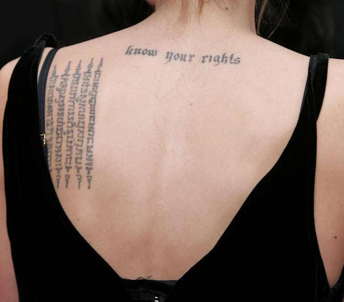 One of the actress' most famous tattoos sits at the top of her back [Photo: Getty]