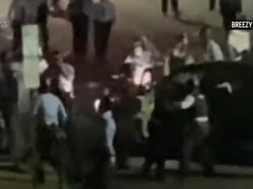 A screengrab of video showing officers and protesters surround Rickia Young's vehicle (AP/CBSPHilly)
