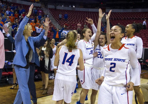 Boise State players in celebration of their win over Nevada in the NCAA college basketball women's championship game in the Mountain West Conference tournament Friday, March 9, 2018, in Las Vegas. (AP Photo/L.E. Baskow)