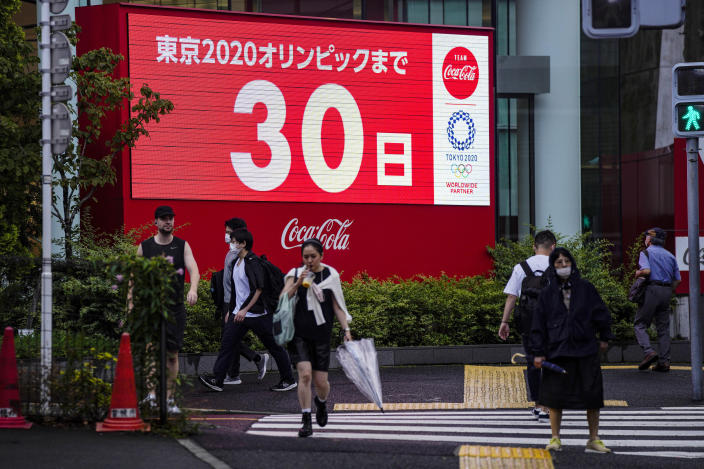 A countdown clock shows 30 days to the opening ceremony of the Tokyo 2020 Olympic Games Wednesday, June 23, 2021, in Tokyo. (AP Photo/Kiichiro Sato)