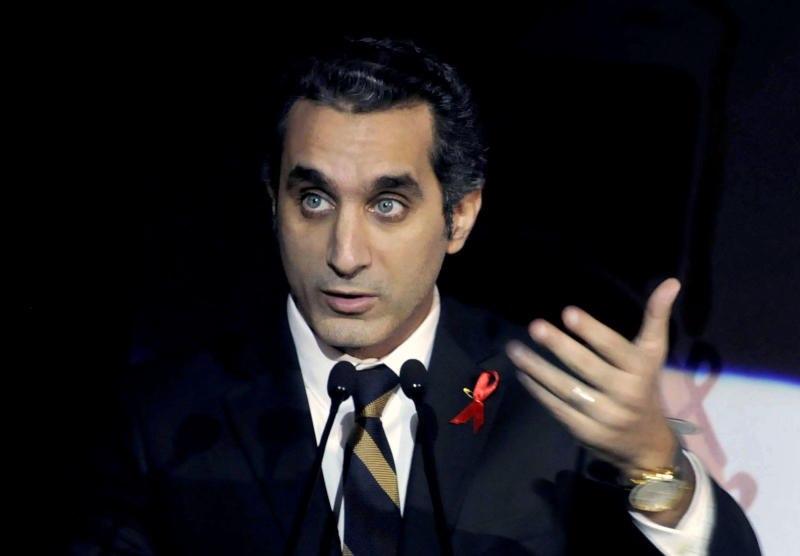 """FILE - In this Saturday Dec. 8, 2012 file photo, Egyptian TV host Bassem Youssef addresses attendants at a gala dinner party in Cairo, Egypt. After more than four months away, the man known as """"Egypt's Jon Stewart"""" returns the airwaves Friday in a country radically different from the one he previously mocked. Satirist Bassem Youssef's weekly """"El-Bernameg,"""" or """"The Program"""" in Arabic, mocked the country's first elected Islamist president and his supporters for mixing religion and politics, took them to task for failing to be inclusive or deliver on people's demands for change_ to the extent that some said he was one of the main reasons people turned against Mohammed Morsi. (AP Photo/Ahmed Omar, File)"""