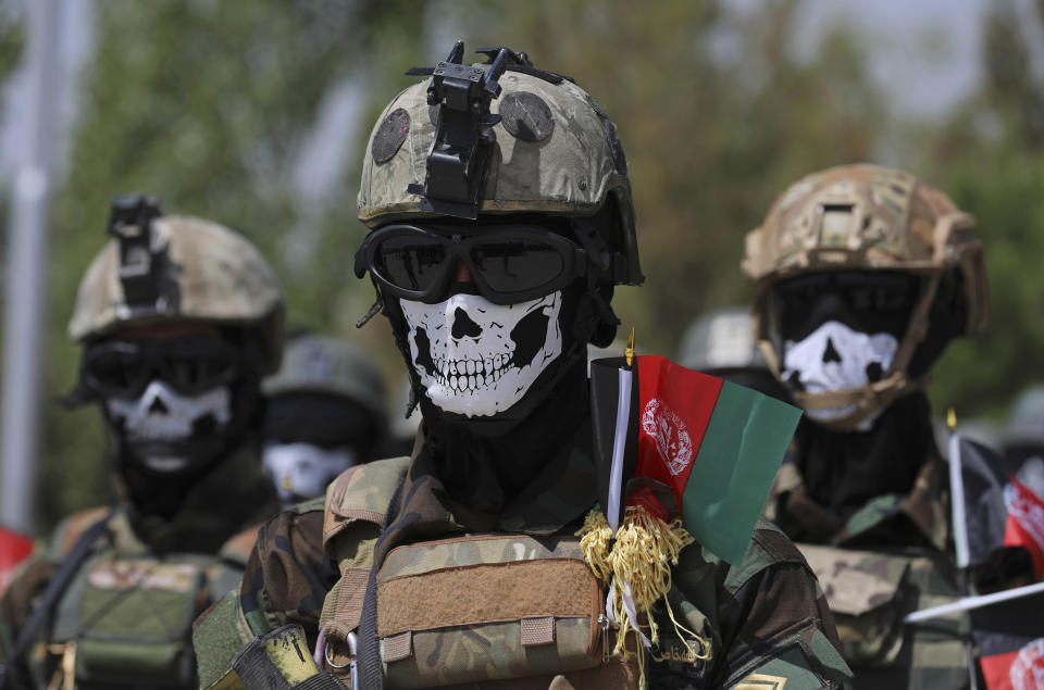 FILE - In this July 17, 2021 file photo, masked Afghan Army Special Forces attend their graduation ceremony after a three-month training program at the Kabul Military Training Center, in Kabul, Afghanistan. The US and NATO have promised to pay $4 billion a year until 2024 to finance Afghanistan's military and security forces, which are struggling to contain an advancing Taliban. Already since 2001, the U.S. has spent nearly $89 billion to build, equip and train the forces. (AP Photo/Rahmat Gul, File)