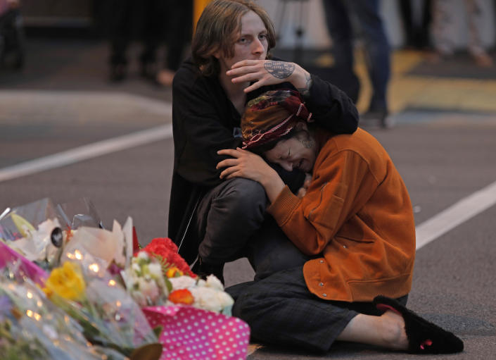 FILE - In this March 16, 2019, file photo, mourners pay their respects at a makeshift memorial near the Masjid Al Noor mosque in Christchurch, New Zealand. More than 60 survivors and family members will confront the New Zealand mosque gunman during the four-day sentencing starting Monday, Aug. 24, 2020. Twenty-nine-year-old Australian Brenton Harrison Tarrant has pleaded guilty to 51 counts of murder, 40 counts of attempted murder and one count of terrorism in the worst atrocity in the nation's modern history. (AP Photo/Vincent Yu, File)