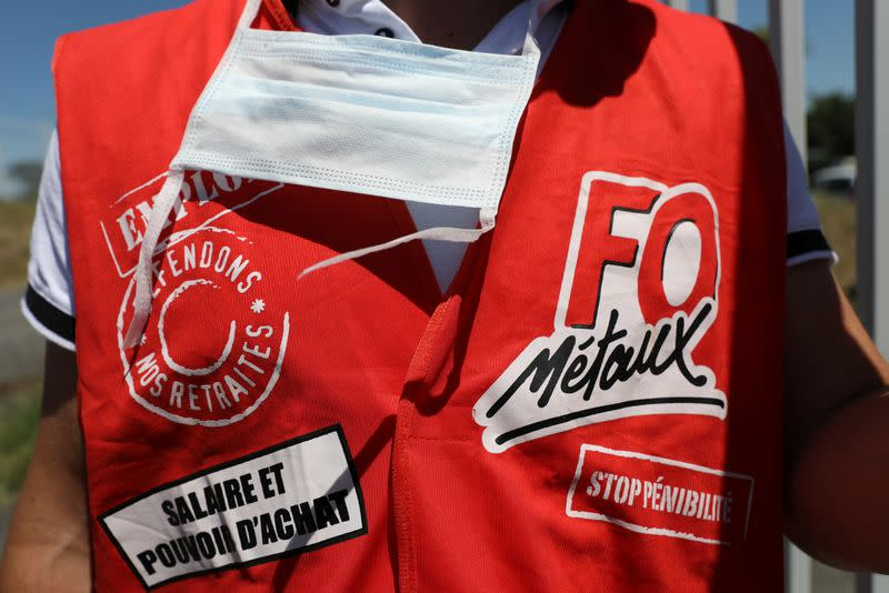 Protester wears a waistcoat with Force Ouvriere (FO) Metaux signage during a demonstration outside the Airbus factory in Blagnac