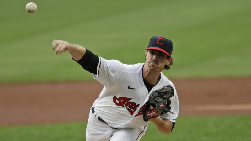 Cleveland Indians starting pitcher Shane Bieber delivers in the first inning in a baseball game against the Minnesota Twins, Tuesday, Aug. 25, 2020, in Cleveland. (AP Photo/Tony Dejak)