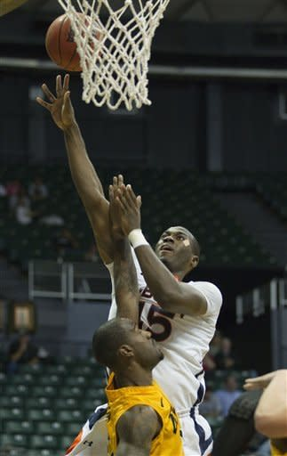 Auburn forward Adrian Forbes (45) ups ups shot while being defended by Long Beach State forward T.J. Robinson, bottom, in the first half of an NCAA college basketball game Friday, Dec. 23, 2011, in Honolulu. (AP Photo/Eugene Tanner)