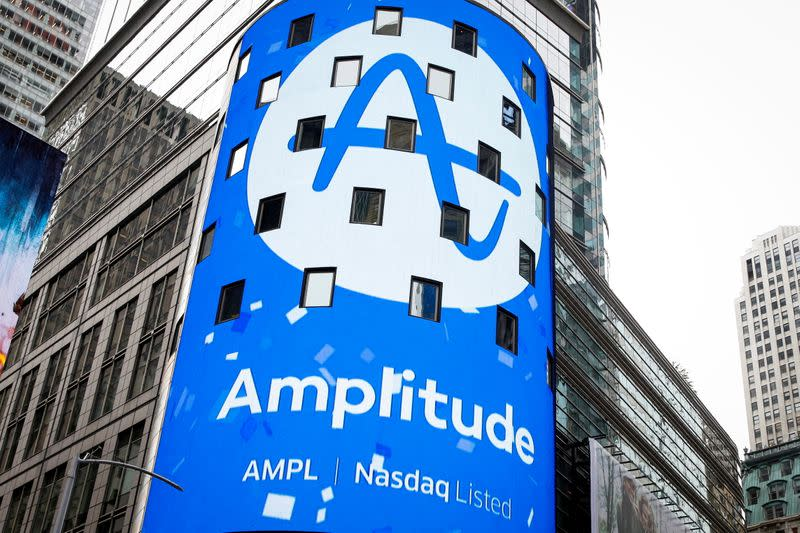 A screen announces Amplitude's direct listing outside the Nasdaq Market in Times Square during in New York