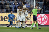 Los Angeles FC players, mob, forward Carlos Vela, obscured, after Vela's goal during the first half of an MLS soccer match against Dallas FC Wednesday, June 23, 2021, in Los Angeles. (AP Photo/Marcio Jose Sanchez)