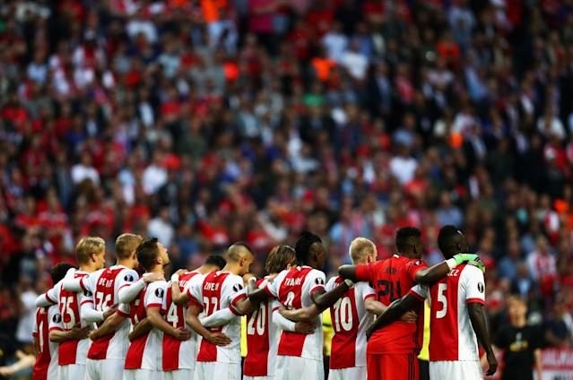 <p>The Ajax team take part in a minutes silence in memory of the victims of the Manchester Concert attack prior to the UEFA Europa League Final between Ajax and Manchester United at Friends Arena on May 24, 2017 in Stockholm, Sweden. (Photo by Dean Mouhtaropoulos/Getty Images) </p>