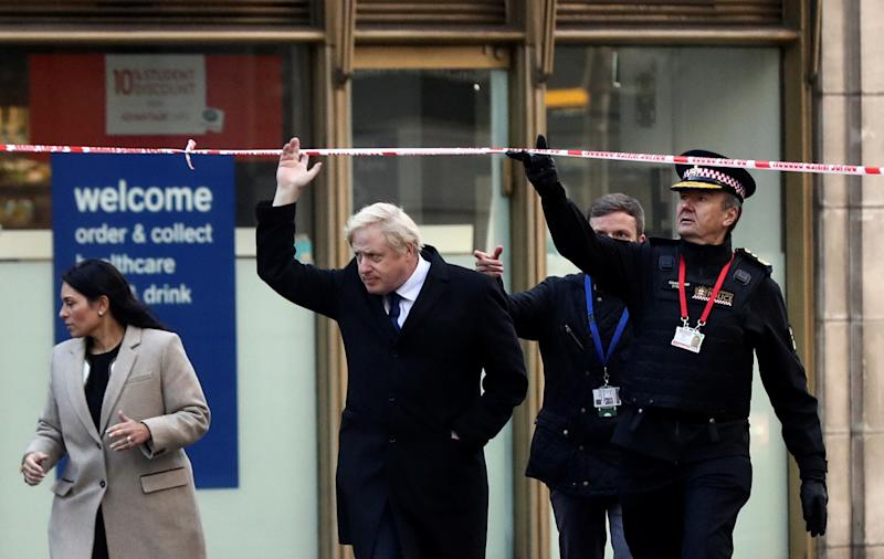 LONDON, ENGLAND - NOVEMBER 30: British Prime Minister Boris Johnson, Home Secretary Priti Patel, (L) and City of London commissioner Ian Dyson (R) visit the scene of yesterday's London Bridge stabbing attack on November 30, 2019 in London, England. A man and a woman were killed and three seriously injured in a stabbing attack at London Bridge during which the suspect was shot dead by Police officers after members of the public restrained him. The Metropolitan Police have named the suspect as 28-year-old Usman Khan.(Photo by Simon Dawson - WPA Pool/Getty Images)
