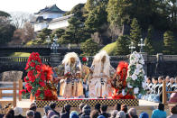In this photo released by Japan Arts Council, Kiyokazu Kanze and other members of the Kanze School of the Japanese traditional theater of Noh perform on stage at the Kyoko Gaien National Garden near Imperial Palace, background, in Tokyo on March 14, 2021. The Japan Cultural Expo, a government-backed program set up especially to drum up tourism during the Tokyo Olympics, was planning similar events for the Games to highlight Japanese culture, but Tokyo Olympic organizers and the IOC on Saturday, March 20, 2021 announced a ban on fans from abroad attending the the games, which open on July 23. (Ken Kikaido/© Japan Arts Council via AP)