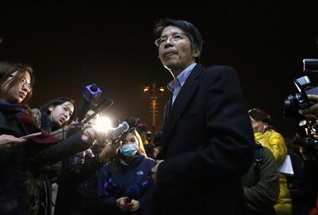 Former Ming Pao chief editor Kevin Lau Chun-to is seen outside his office building in Hong Kong in this January 13, 2014 file photo. REUTERS/Stringer/File