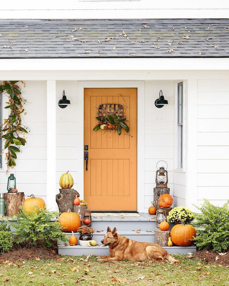 """<p>A few quick DIYs (a tobacco basket filled with mini pumpkins, gourds, and magnolia leaves, a magnolia leaf garland with bittersweet vines nestled throughout) plus a few wood logs and a smattering of pumpkins are all it takes to make your entryway the most inviting on the block.</p><p><a class=""""link rapid-noclick-resp"""" href=""""https://www.amazon.com/Barnyard-Designs-Tobacco-Baskets-Farmhouse/dp/B07K1PN2LW/ref=sr_1_3?tag=syn-yahoo-20&ascsubtag=%5Bartid%7C10050.g.2063%5Bsrc%7Cyahoo-us"""" rel=""""nofollow noopener"""" target=""""_blank"""" data-ylk=""""slk:SHOP TOBACCO BASKET"""">SHOP TOBACCO BASKET</a></p>"""