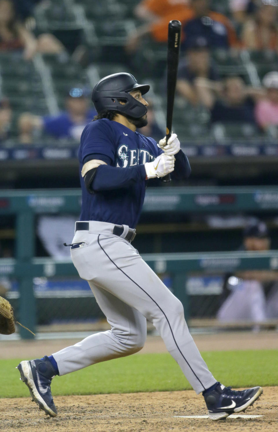Seattle Mariners' Dillon Thomas watches his two-run single during the 11th inning against the Detroit Tigers in a baseball game Wednesday, June 9, 2021, in Detroit. The Mariners won 9-6. (AP Photo/Duane Burleson)