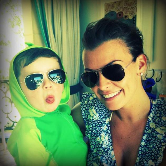 """Celebrity photos: Coleen Rooney is currently sunning herself on holiday with husband Wayne and their son, Kai. The star took some time out to tweet this cute picture of her and Kai, along with the caption: """"Me and my cool dude!"""""""