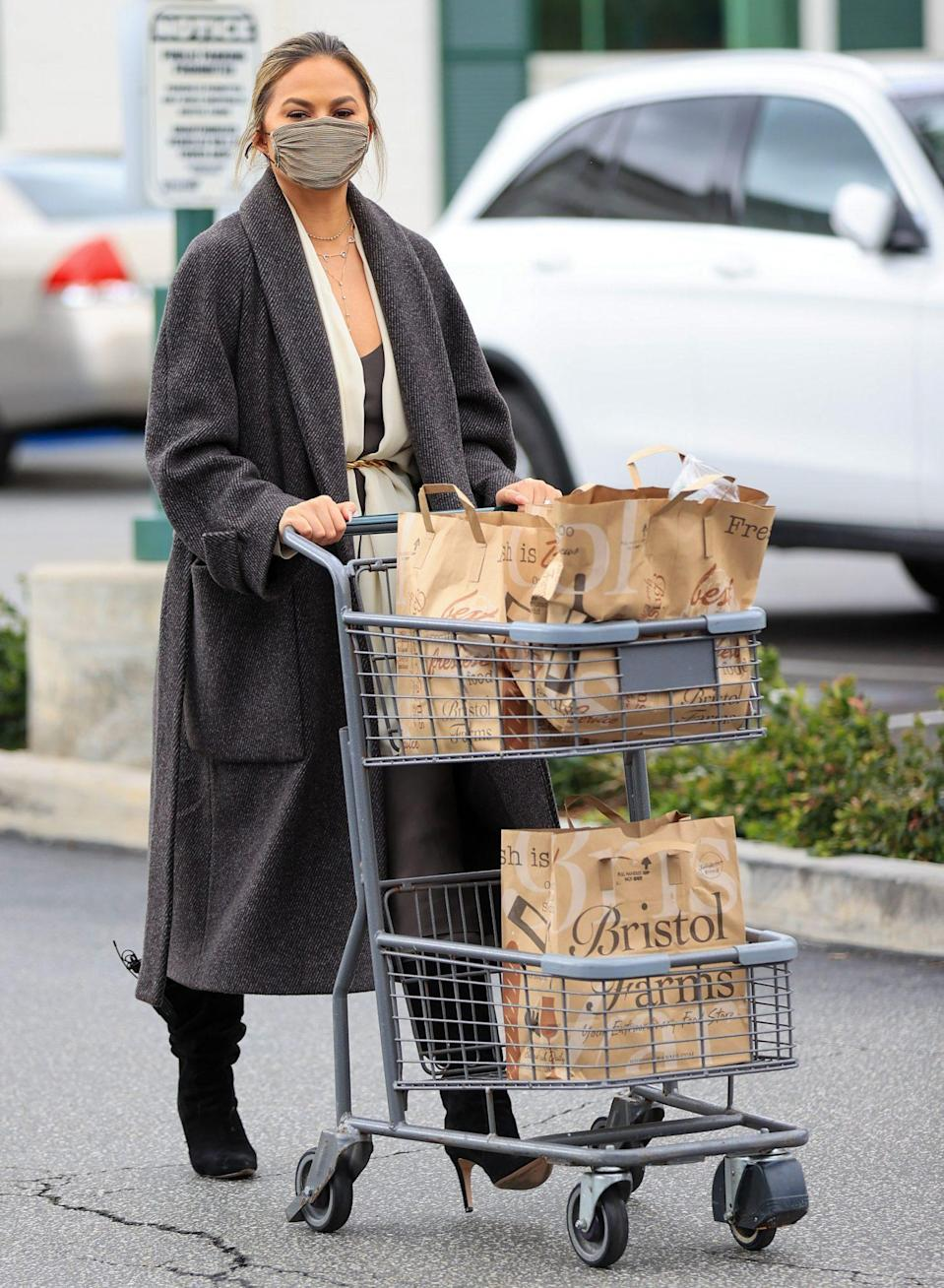 <p>Chrissy Teigen makes a grocery run in Los Angeles on Monday.</p>