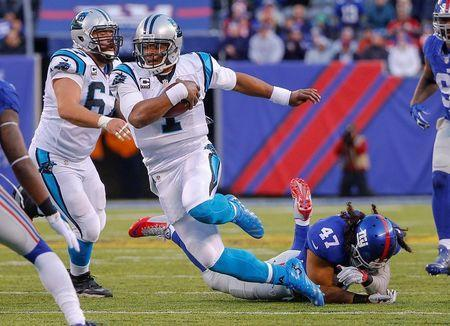 Dec 20, 2015; East Rutherford, NJ, USA; Carolina Panthers quarterback Cam Newton (1) runs after breaking tackle by New York Giants middle linebacker Uani' Unga (47) during the fourth quarter at MetLife Stadium. Mandatory Credit: Jim O'Connor-USA TODAY Sports