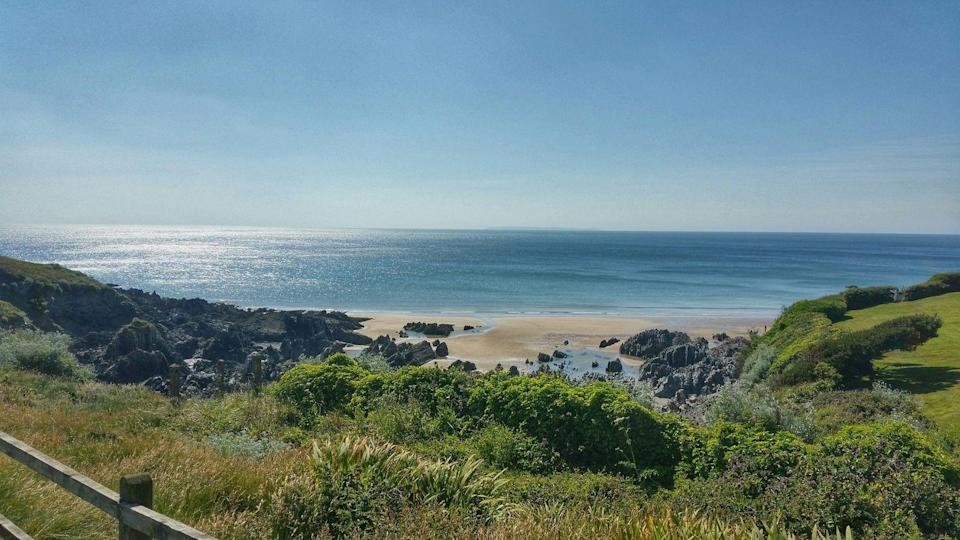 "<p>Woolacombe Beach is renowned for being family friendly, and providing a lifeguard service, toilets, first aid and food and beach goods outlets.</p><p><a class=""link rapid-noclick-resp"" href=""https://www.airbnb.co.uk/"" rel=""nofollow noopener"" target=""_blank"" data-ylk=""slk:FIND AN AIRBNB"">FIND AN AIRBNB</a></p>"