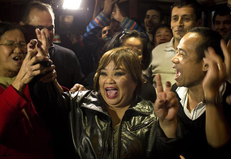 Rose Fostanes -- a Filipina migrant carer -- celebrates with friends and family after winning Israel's 'X-Factor' singing contest in Tel Aviv, on January 15, 2014
