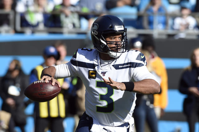 Seattle Seahawks quarterback Russell Wilson (3) passes during the first half of an NFL football game against the Carolina Panthers in Charlotte, N.C., Sunday, Dec. 15, 2019. (AP Photo/Mike McCarn)