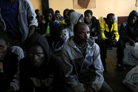 Gambian migrants who voluntarily returned from Libya sit as they wait for registration at the airport in Banjul, Gambia April 4, 2017.    REUTERS/Luc Gnago