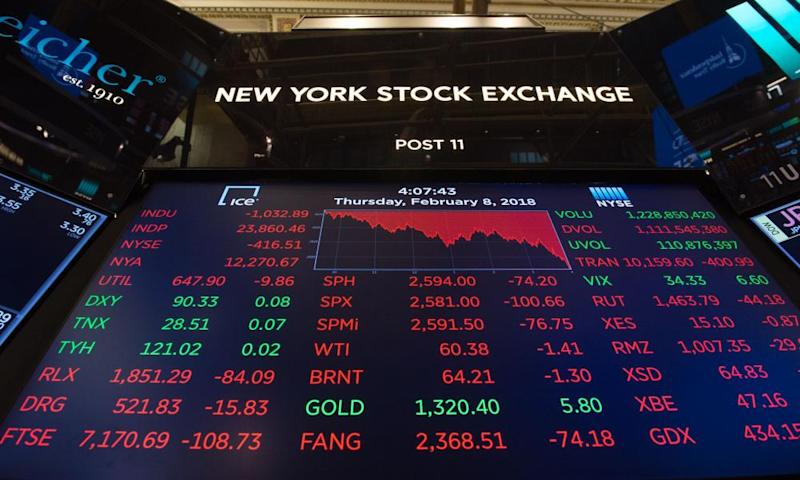 Figures at the New York stock exchange, as worries over interest rate hikes affected the markets.