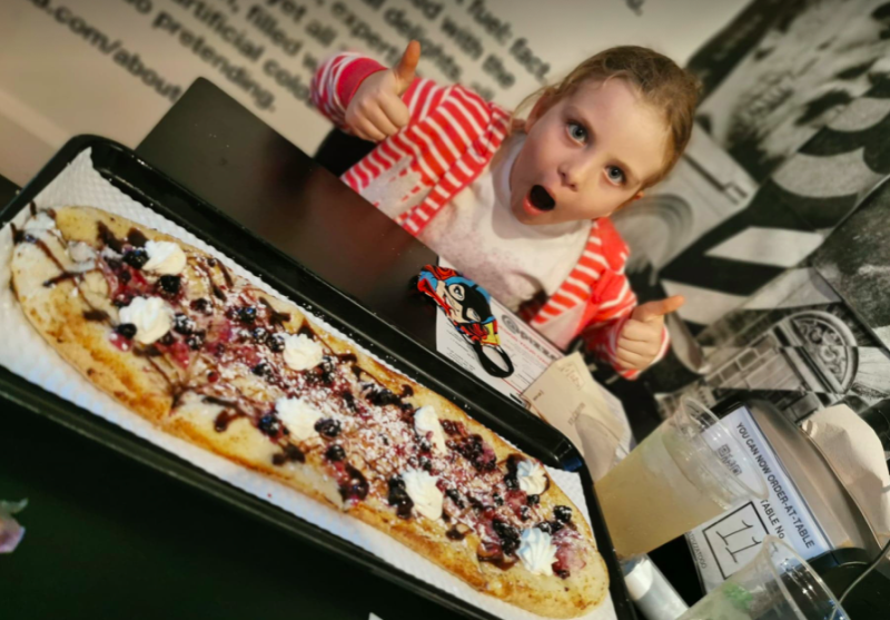 Daniel Davies-Luke's daughter Luna gets ready to tuck into a meal at @Pizza in Edinburgh. (Daniel Davies-Luke)