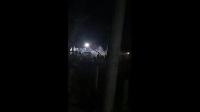 An amateur video shows security forces firing to break up an anti-coup protest in northern Myanmar