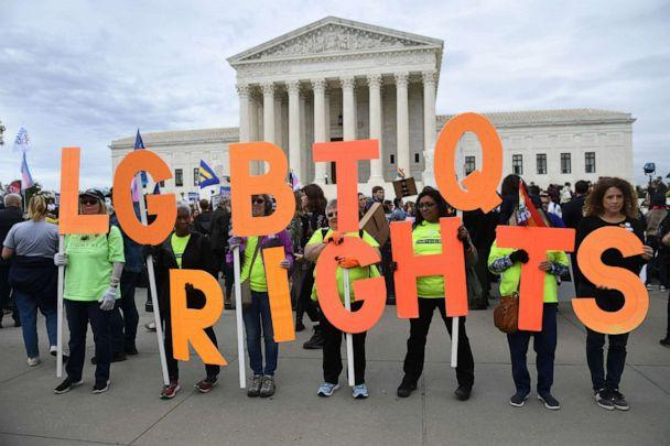PHOTO: Demonstrators in favor of LGBT rights rally outside the US Supreme Court in Washington, D.C., Oct. 8, 2019. (Saul Loeb/AFP via Getty Images)